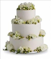 Freesia and Ranunculus Cake Decoration by McAdams Floral, your Victoria, Texas (TX) Florist
